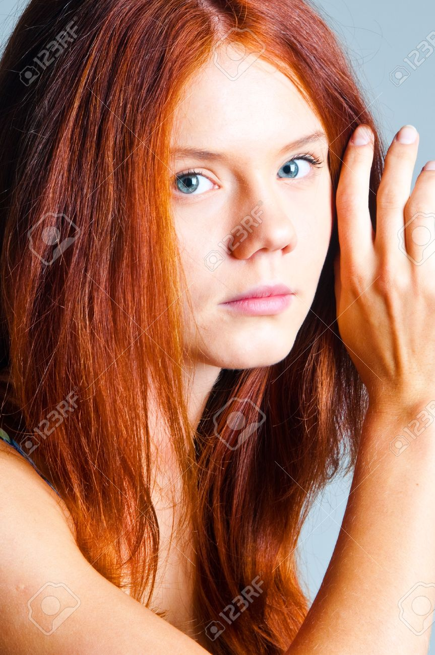 The Red Haired Girl On A Gray Background