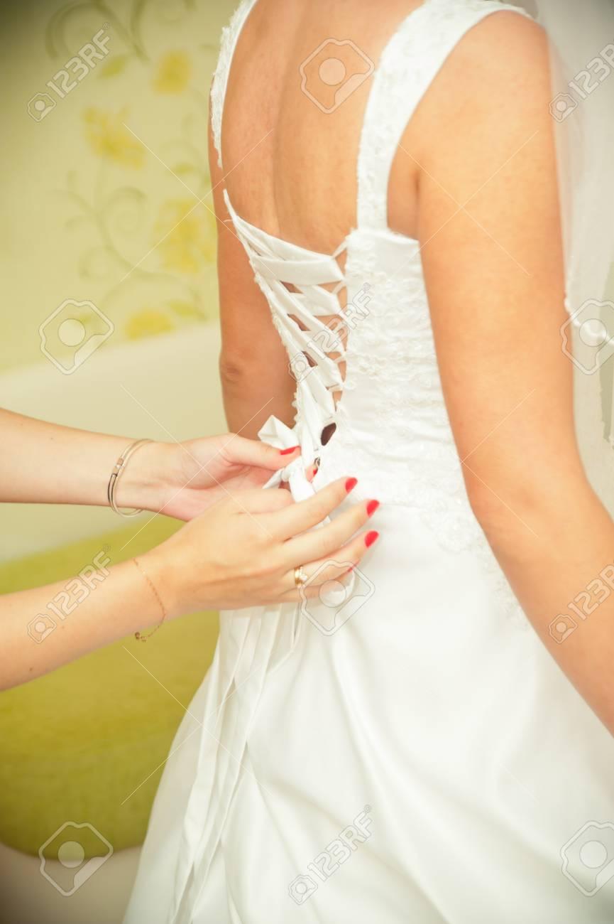 Closeup Of Lace Corset Wedding Dress Of The Bride Stock Photo