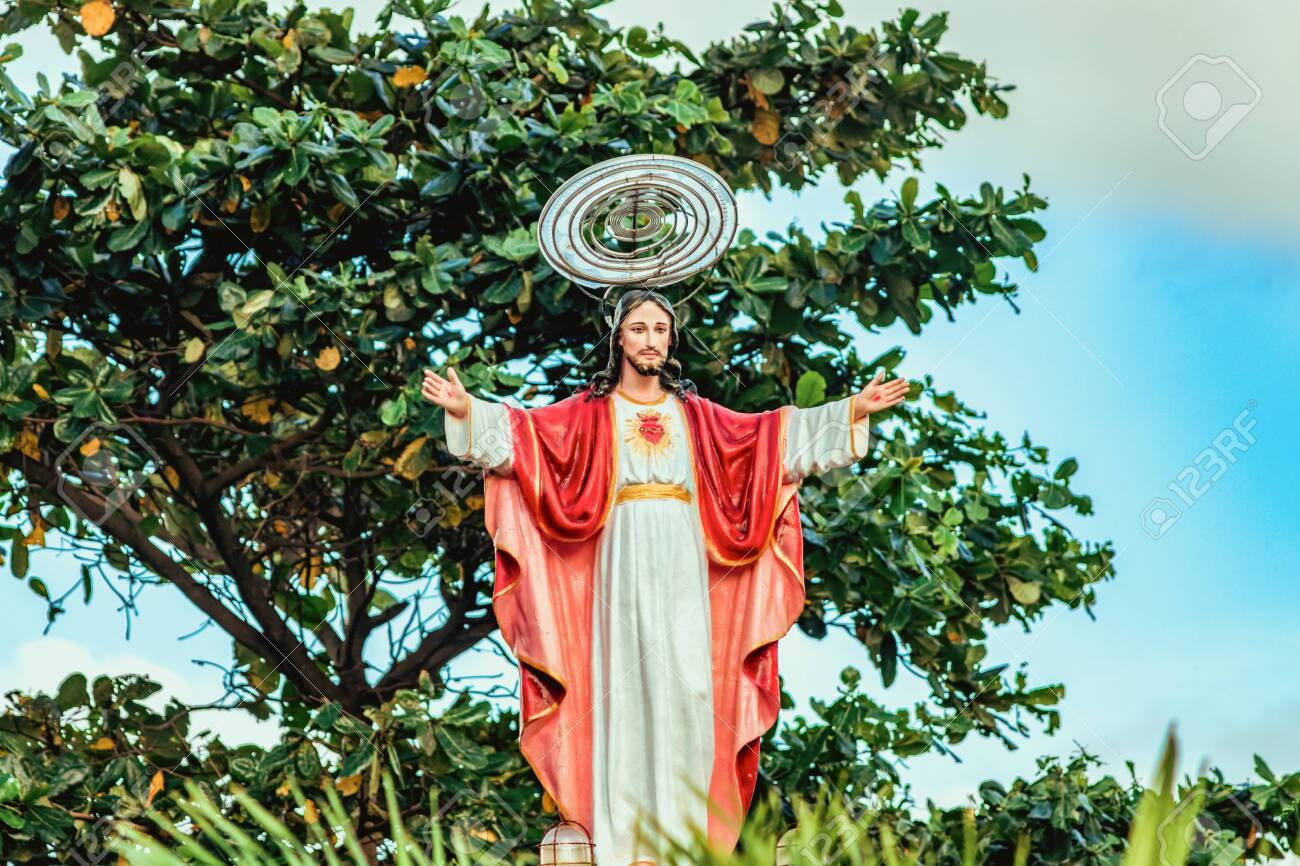 Jesus Christ Stands With Raised Hands In Red White Robes And Stock Photo Picture And Royalty Free Image Image 135332290