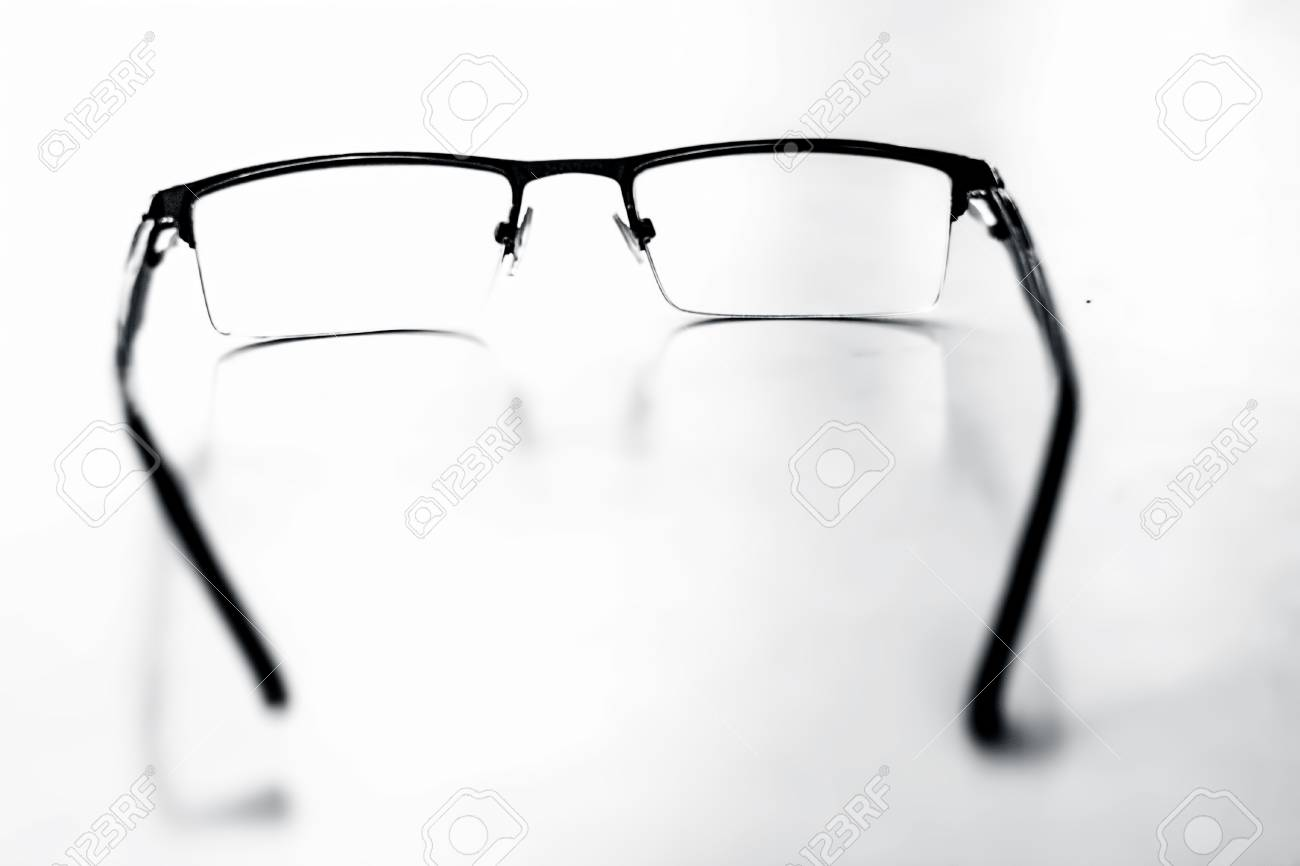 22cd08810dd Black colored half frame rim reading glasses or spectacles to cure eye  disease myopia. Stock