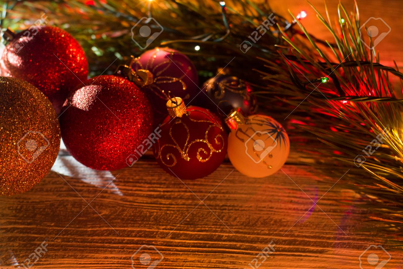 Christmas Ball Garlands.Round New Year Garland On A Wooden Background Christmas Decorations