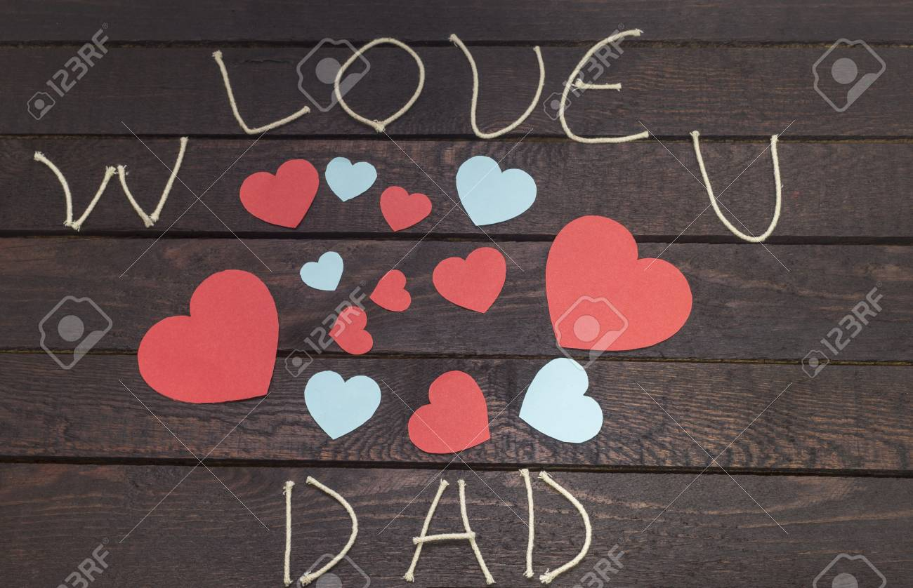 Forming The Word W Love U Dad On Wooden Background Stock Photo