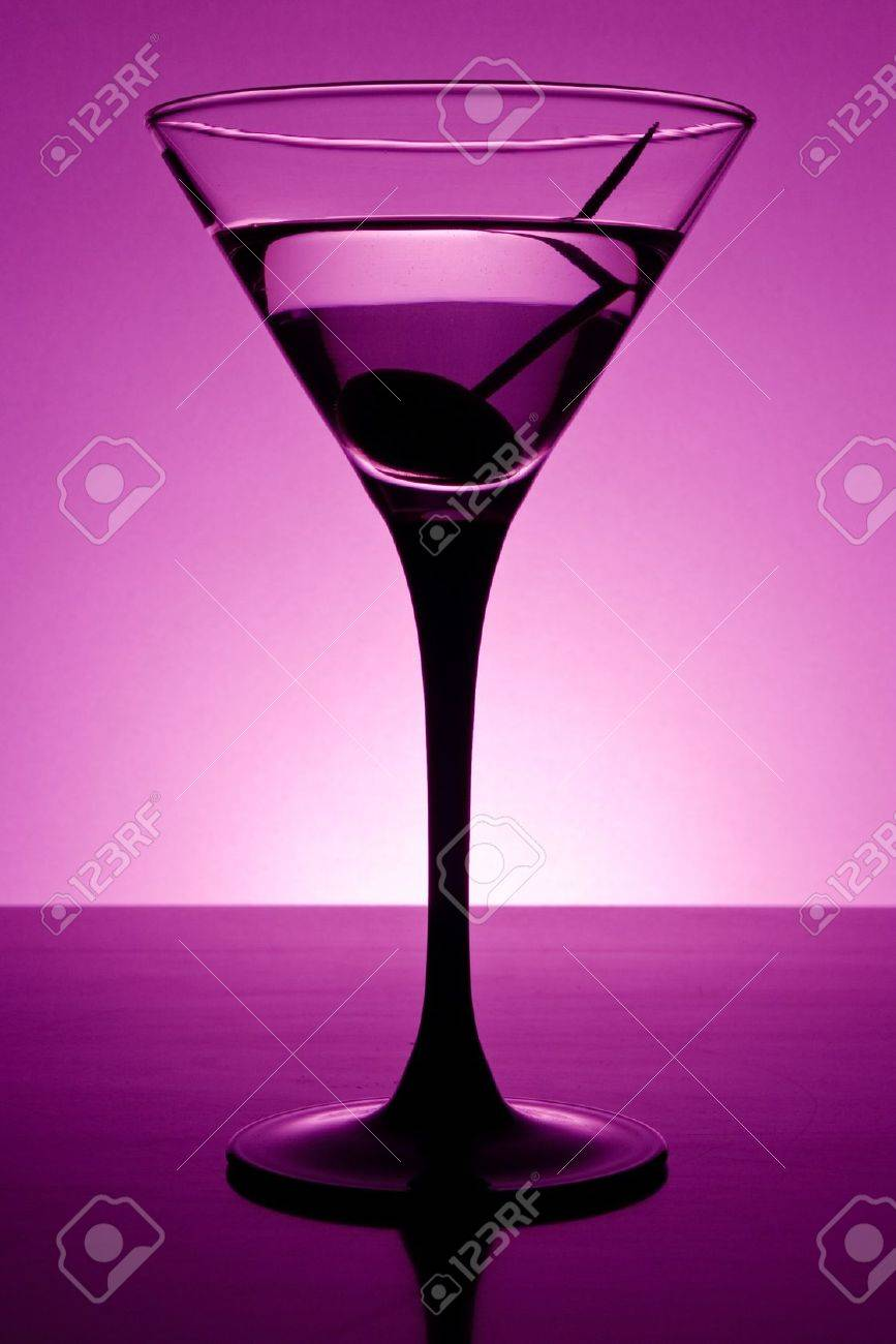 Martini glass on table in purple light Stock Photo - 8964343