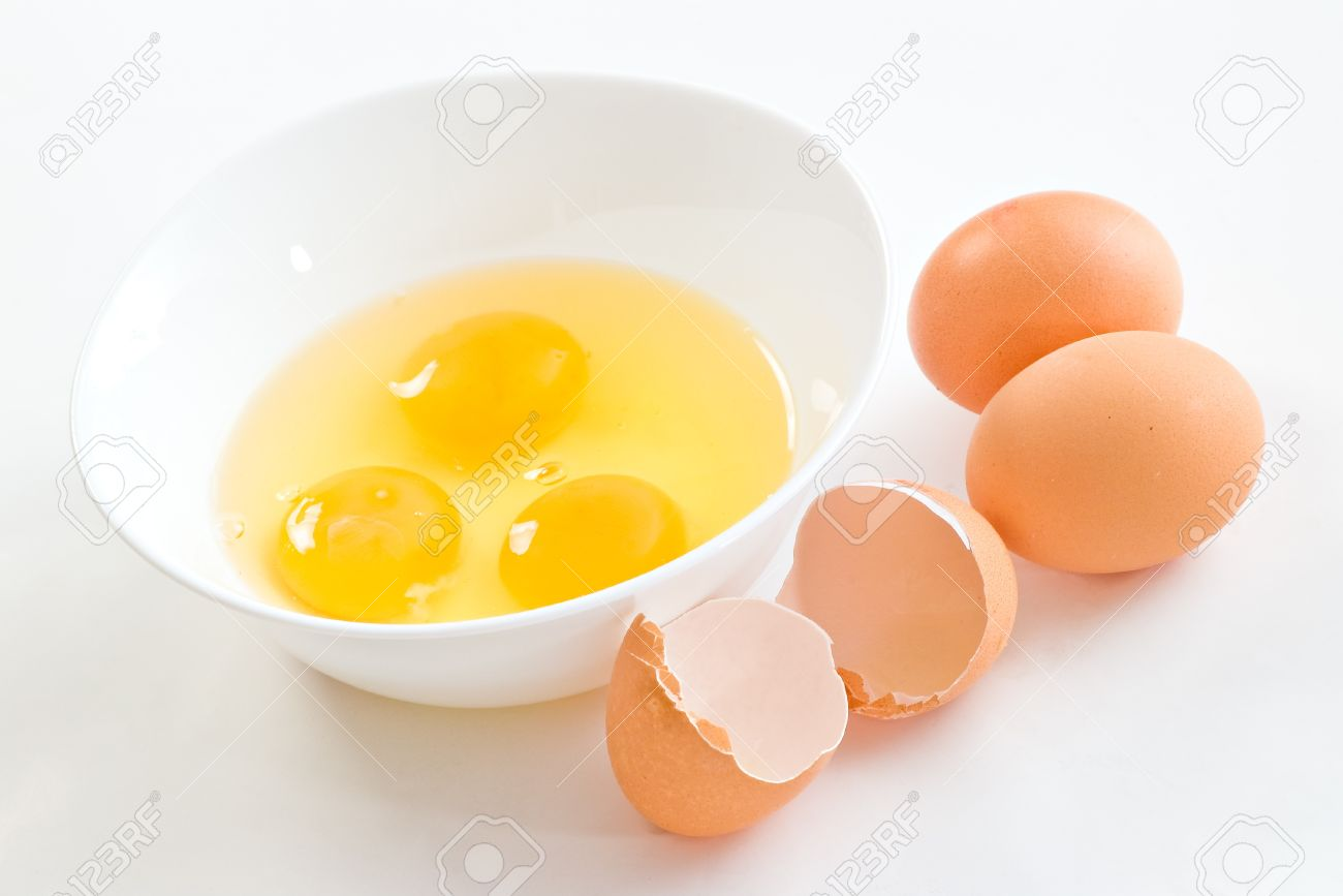 Cracked Eggs In Bowl And Egg Shells On White Stock Photo, Picture ...