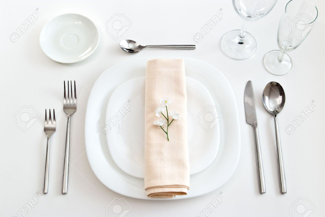 place setting with white plates forks glasses beige napkin and little flower Stock Photo - 9786891 & Place Setting With White Plates Forks Glasses Beige Napkin And ...