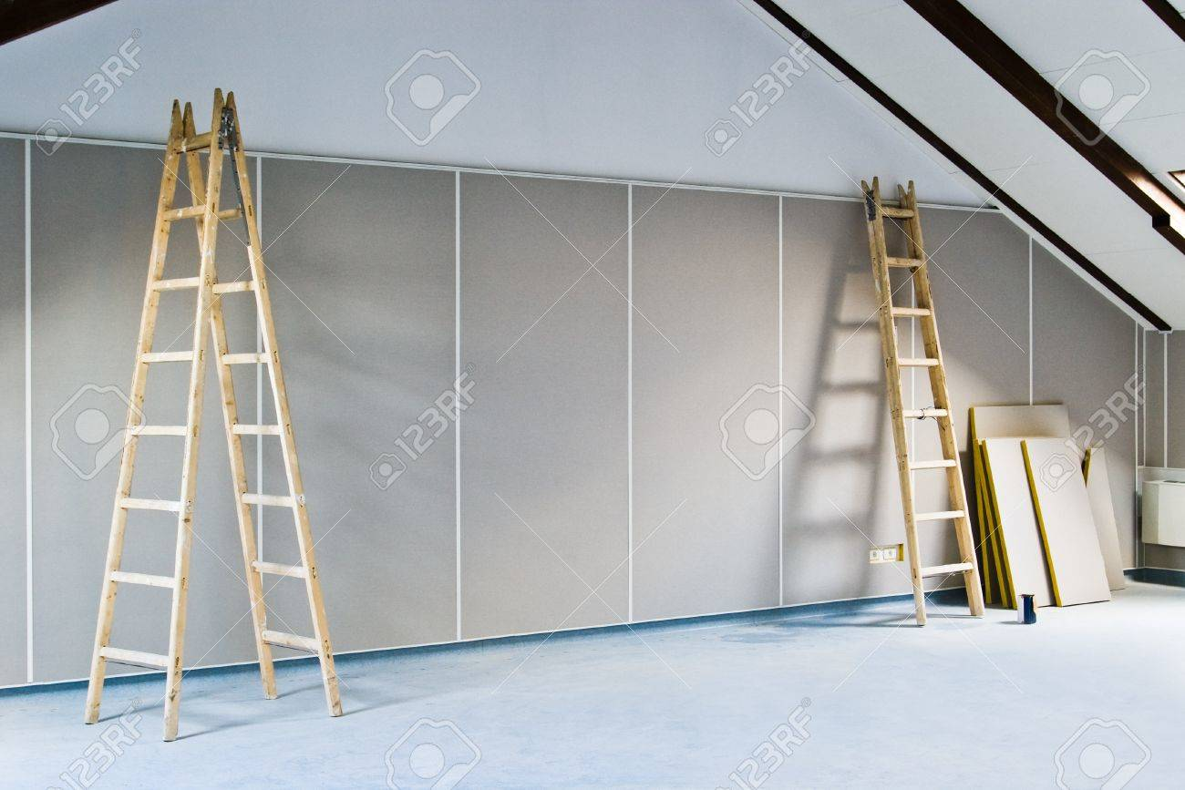 renovation interior with two ladders and wall - 9914200