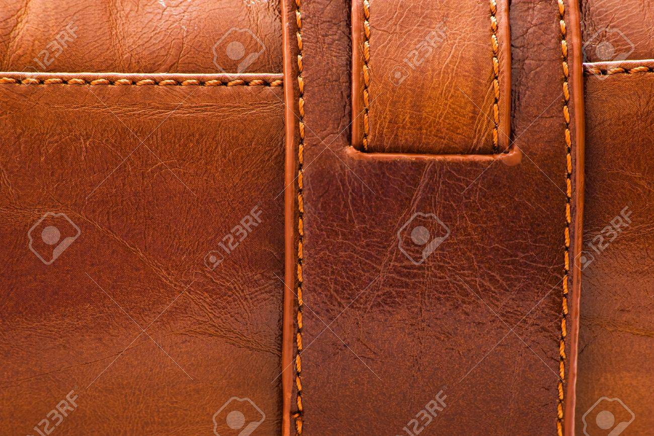 sewed brown leather background for texture - 9908537