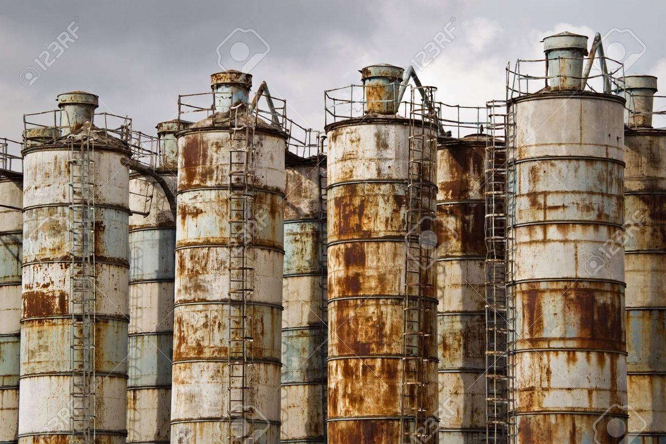 abandoned old rusty industrial containers - 10775972