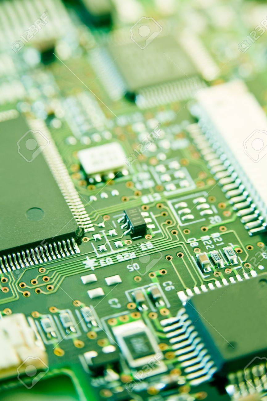 modern electronics with shallow depth of field in green - 13055626