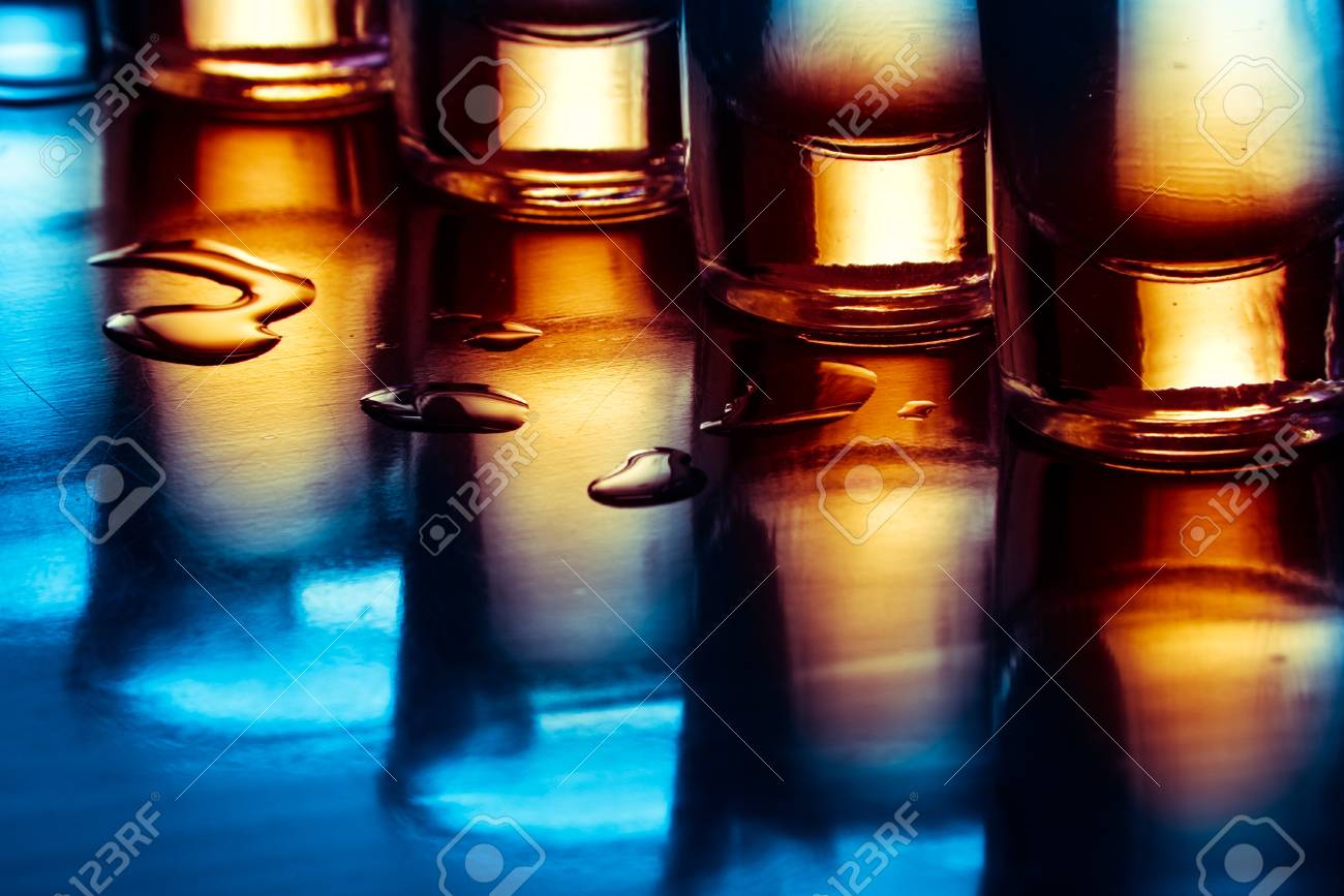 tequila drinks on tap room in blue light Stock Photo - 13146656