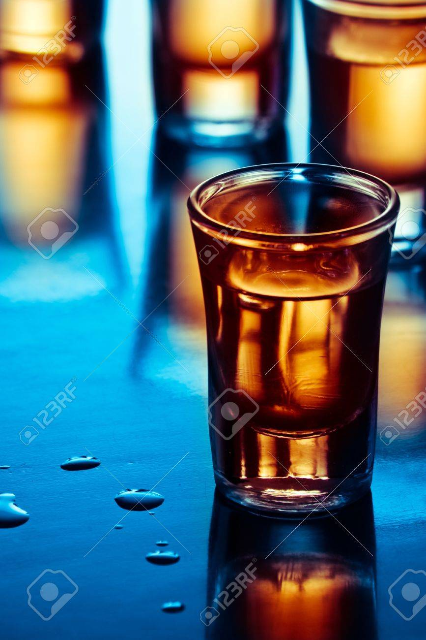 tequila drink on tap room in blue light - 13319063