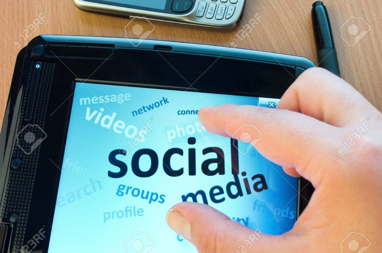 social media and connected words on tablet-pc with fingers touching screen - 13999449