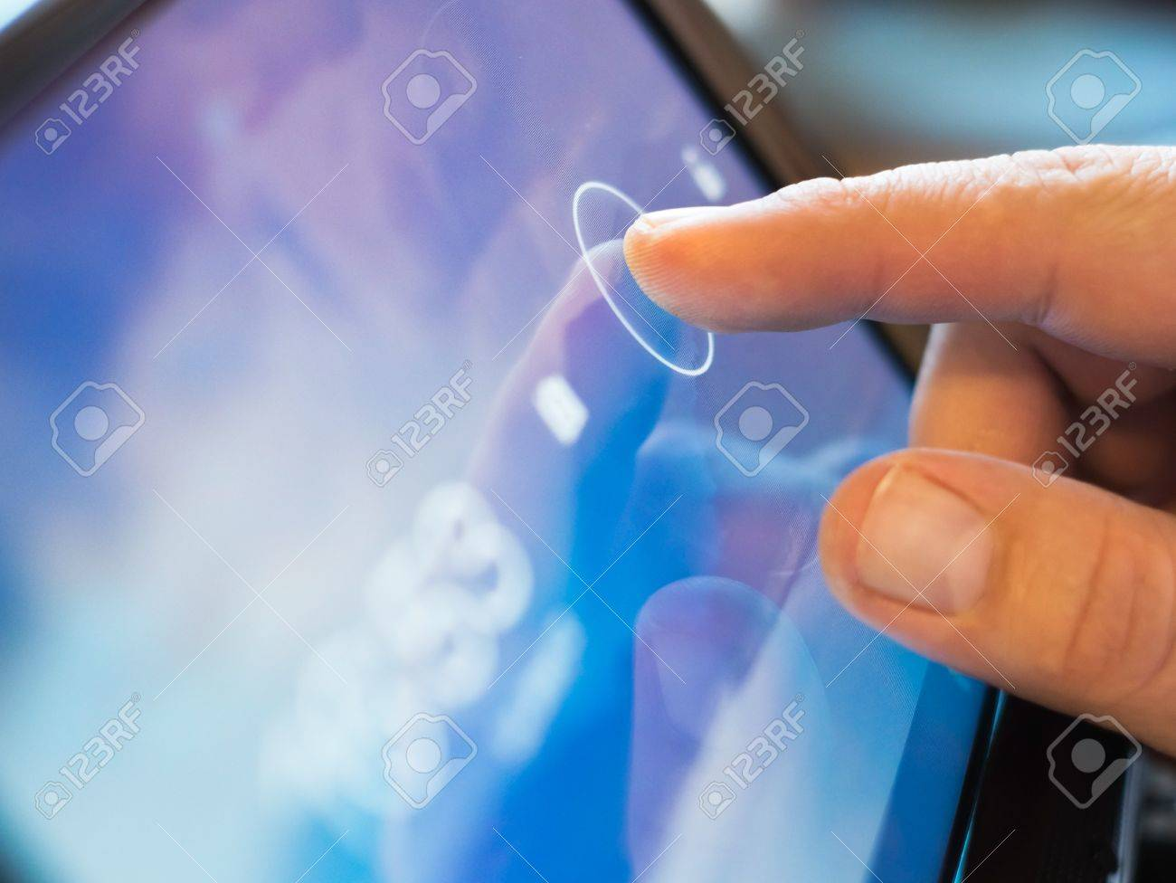 finger touching screen on tablet-pc with shallow depth of field - 15123908