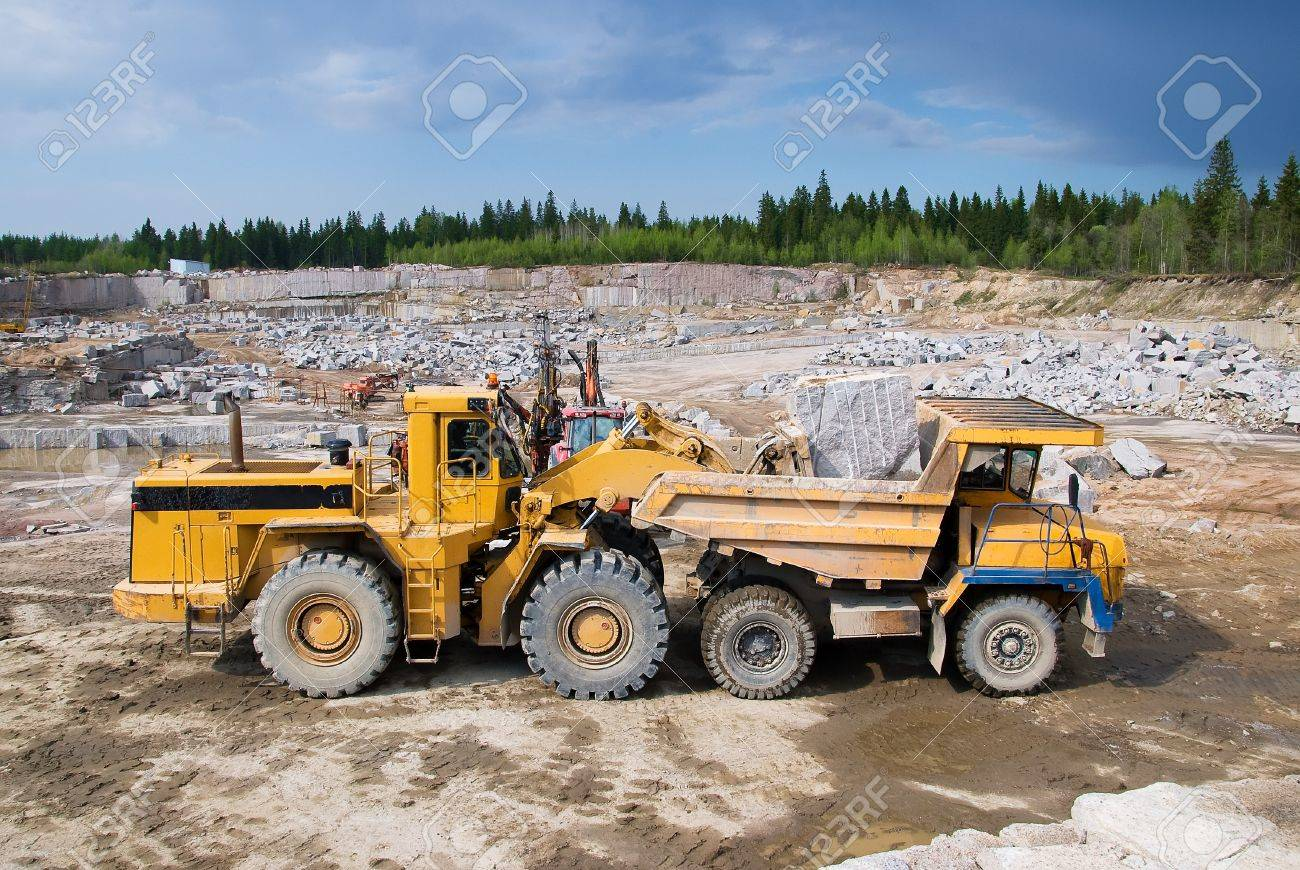 Excavation and dump vehicle in a granite quarry - 13180852