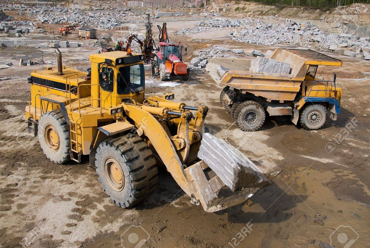 Excavation and dump vehicle in a granite quarry - 13222860