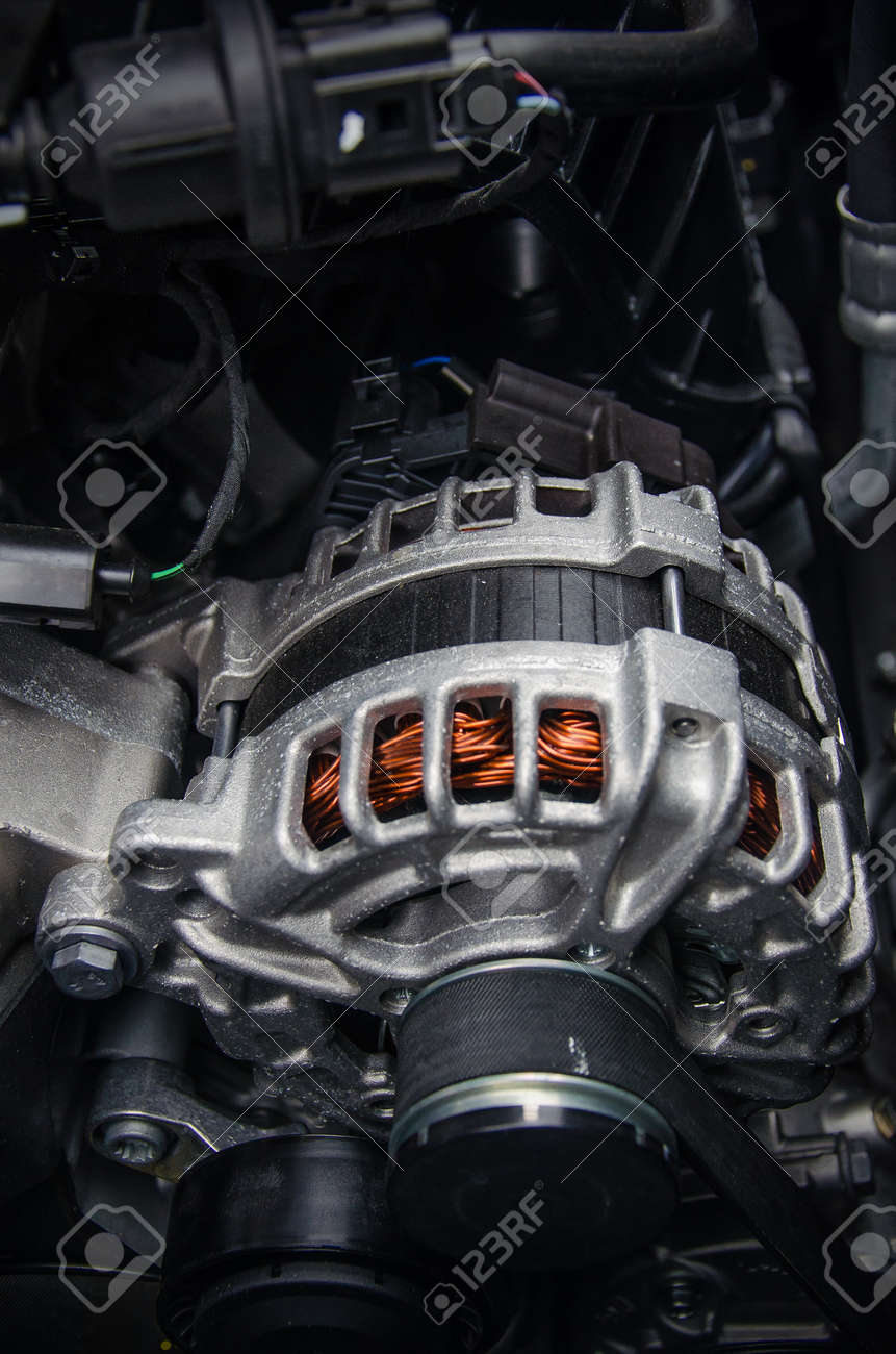 Photo of a car generator. Car parts under the hood of a car. - 164762200