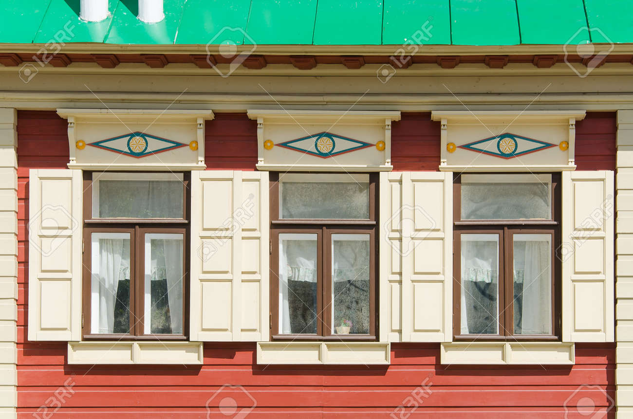 Beautiful wooden windows in an old house in the city of Kazan, Russia. Windows with carved platbands. - 166653061