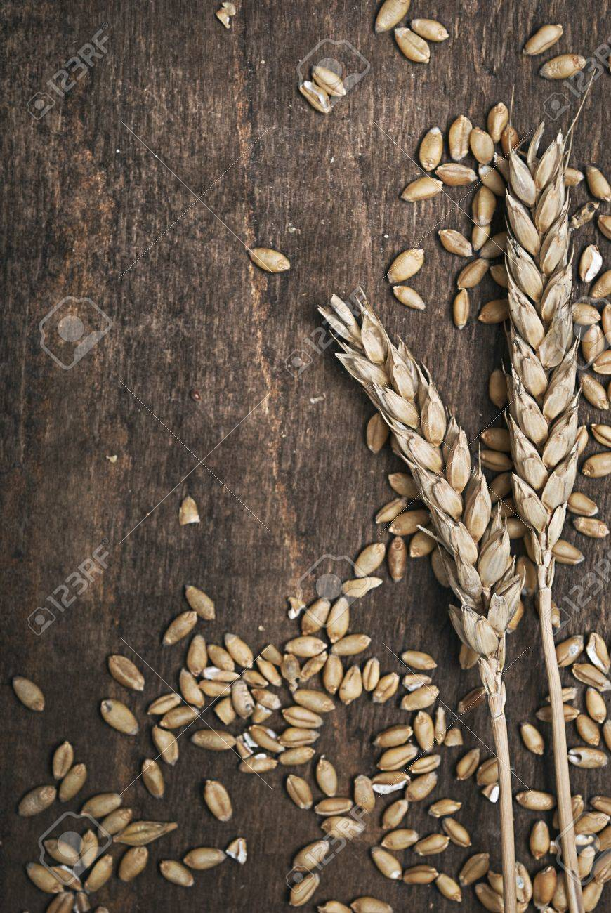 Wheat ears on an old wooden plank Stock Photo - 8992349