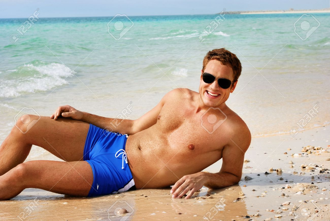 Happy Smiling Man Laying On The Beach Stock Photo 10163427