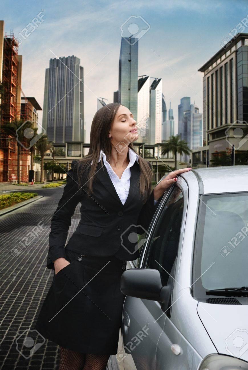 Beautiful business woman standing near her car Stock Photo - 13625235