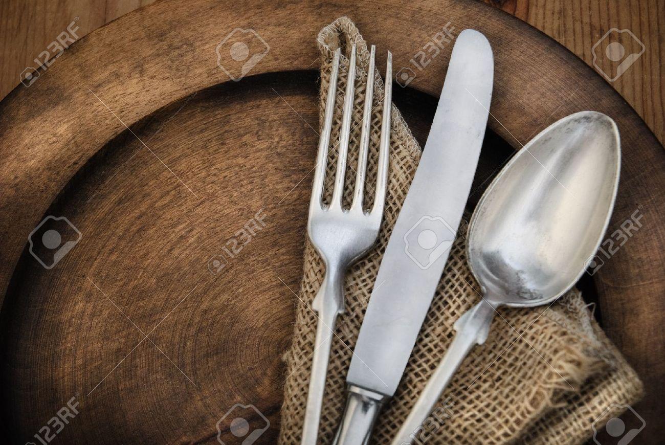 Vintage silverware on rustick wooden plate - 15312683