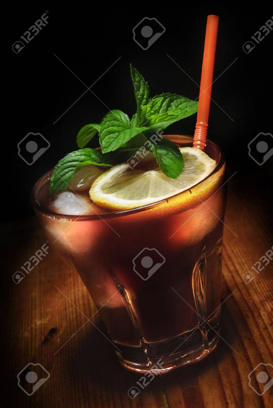 Cuba Libre cocktail on rustic wooden background Stock Photo - 15355593