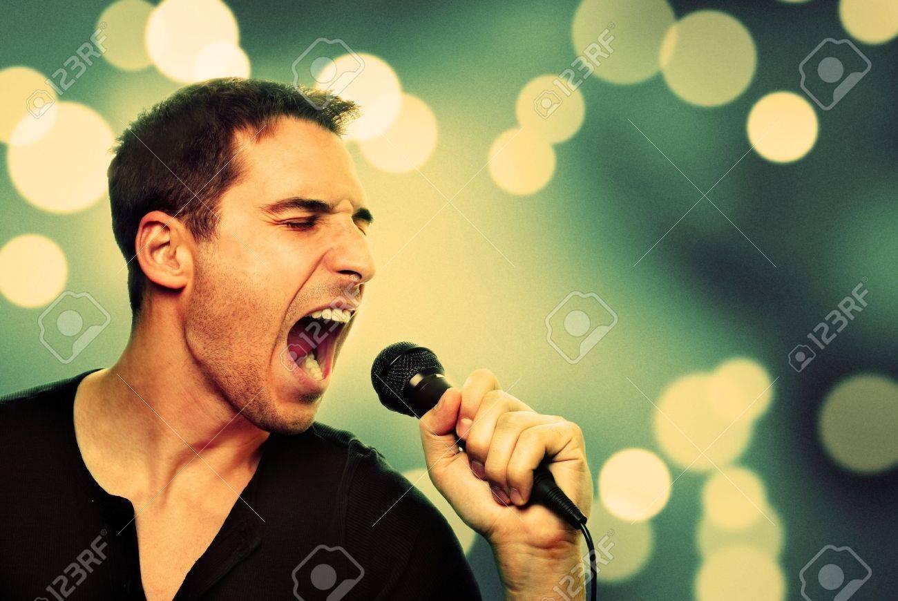 Retro image of man singing into microphone - 16301274