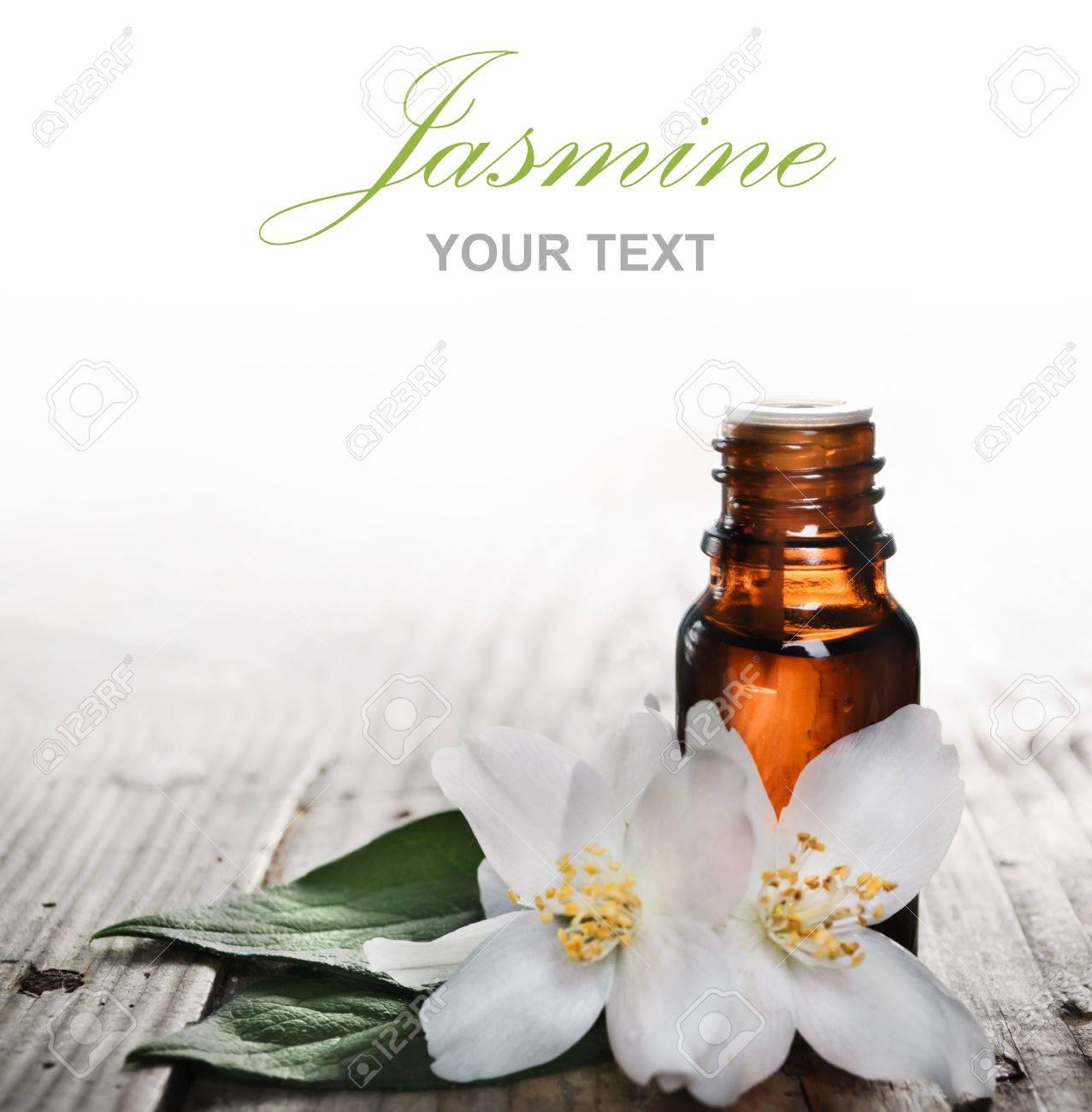 Essential oil with jasmine flower on wooden plank - 16839675