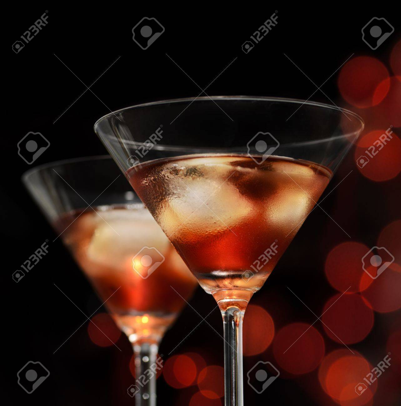 Red cocktail in martini glasses - 17821041
