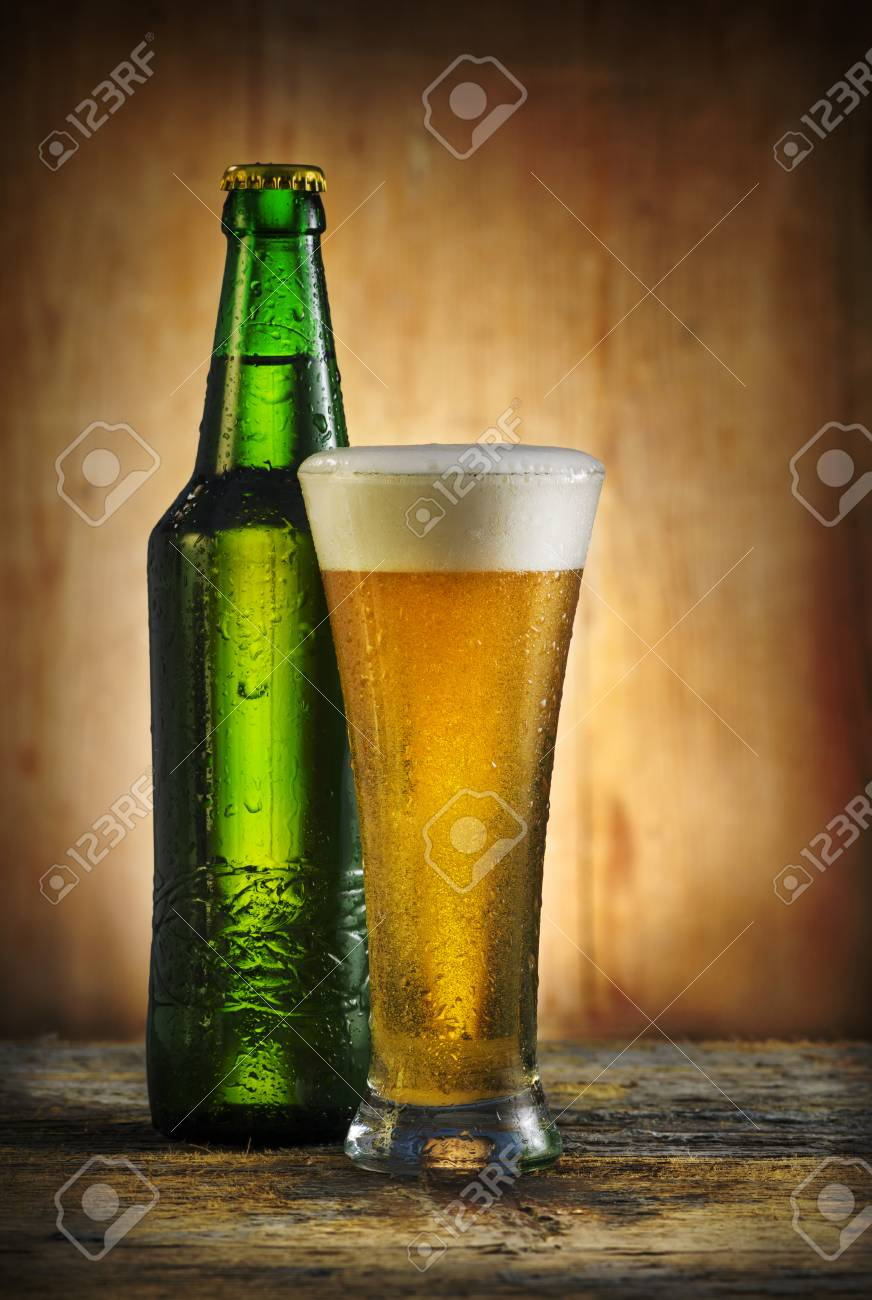 Glass of beer on rustick table Stock Photo - 25311206