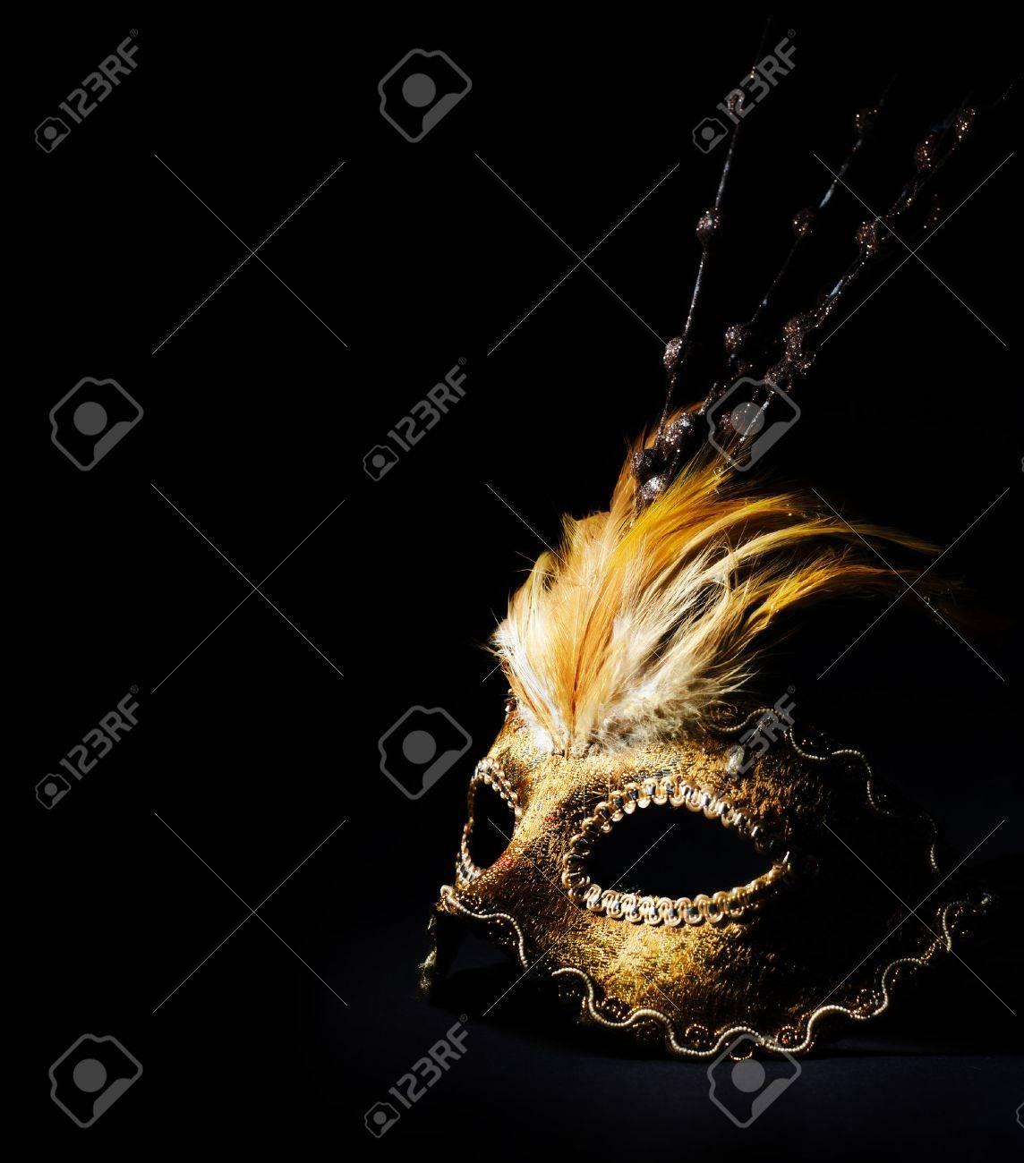 Golden venetian mask over black background - 27742067