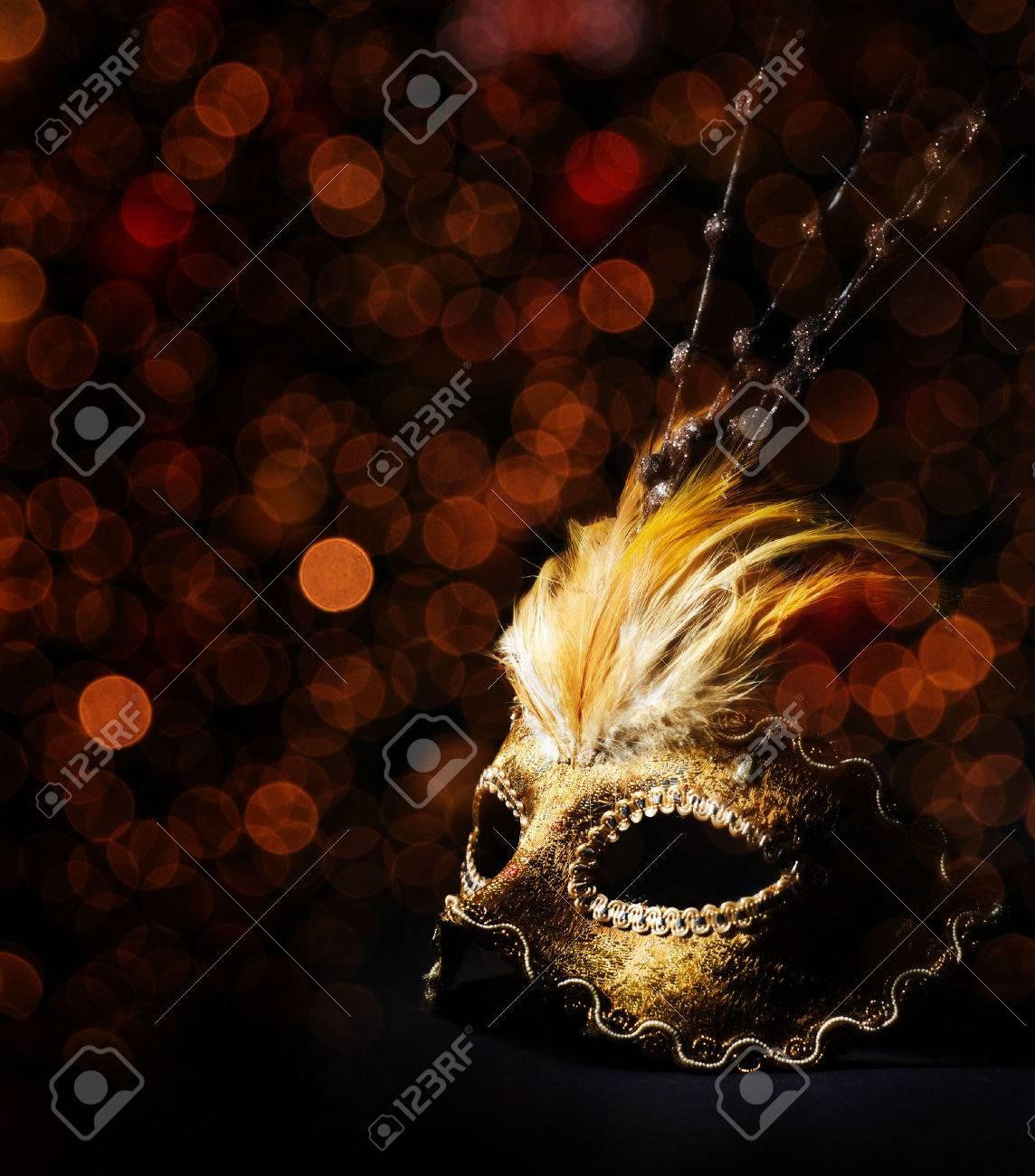 Golden venetian mask over black background - 27742201