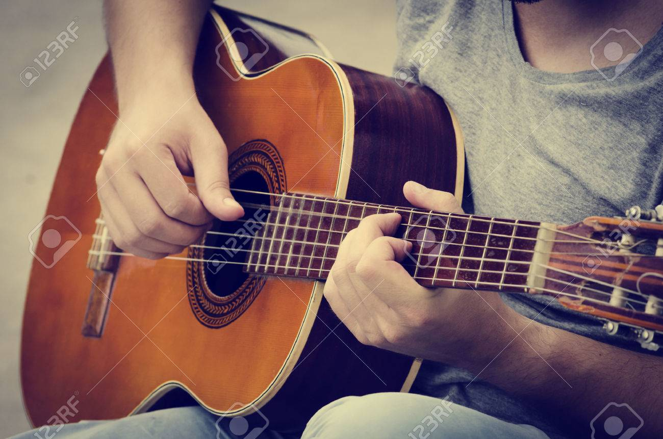 man plays the guitar on the street. retro style. - 30153021