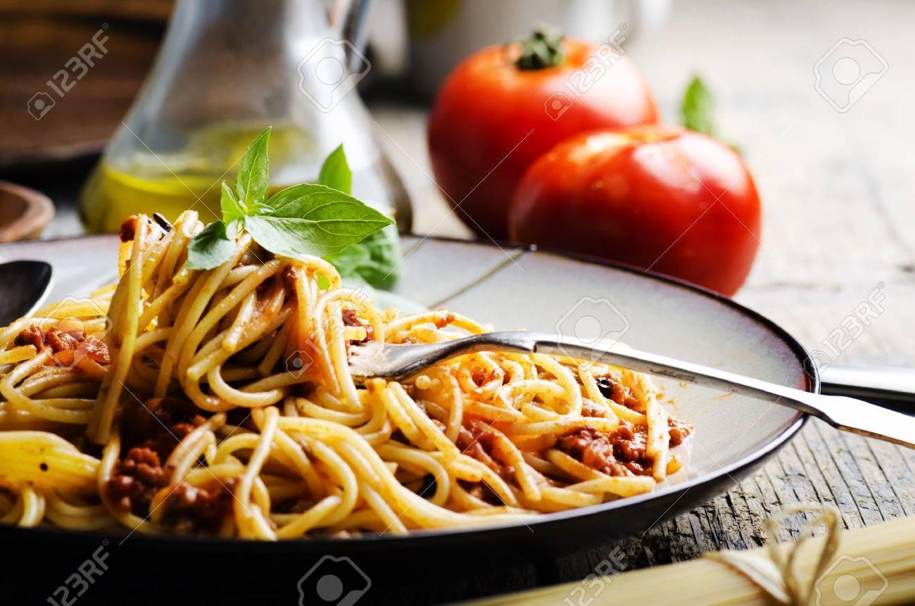 Italian spaghetti on rustic wooden table - 31645232