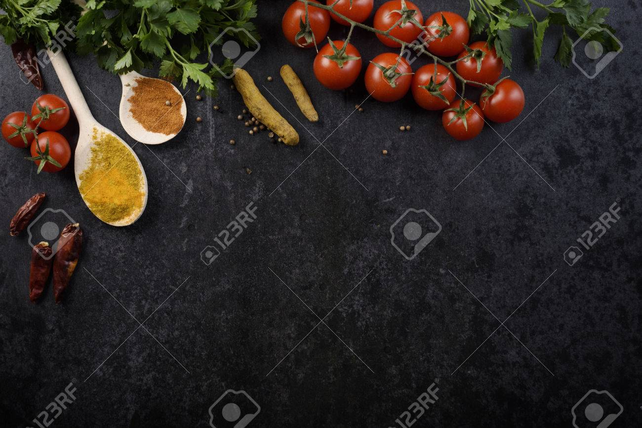 Food ingredients and various spices on black rustic background - 56463387