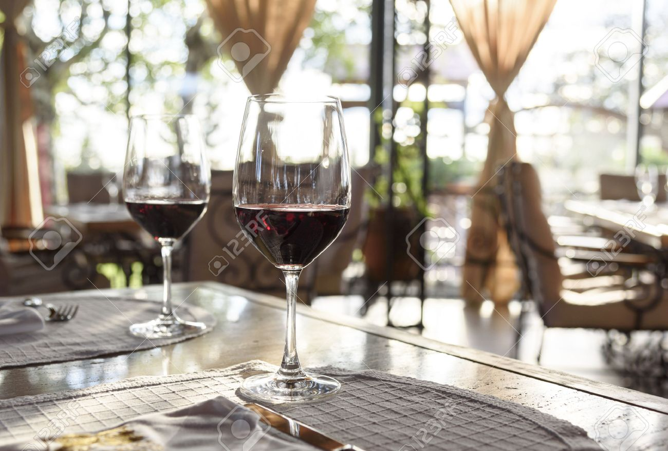 Fancy restaurants interior - Fancy Restaurant Interior And Served Table With Two Glass Of Red Wine Stock Photo
