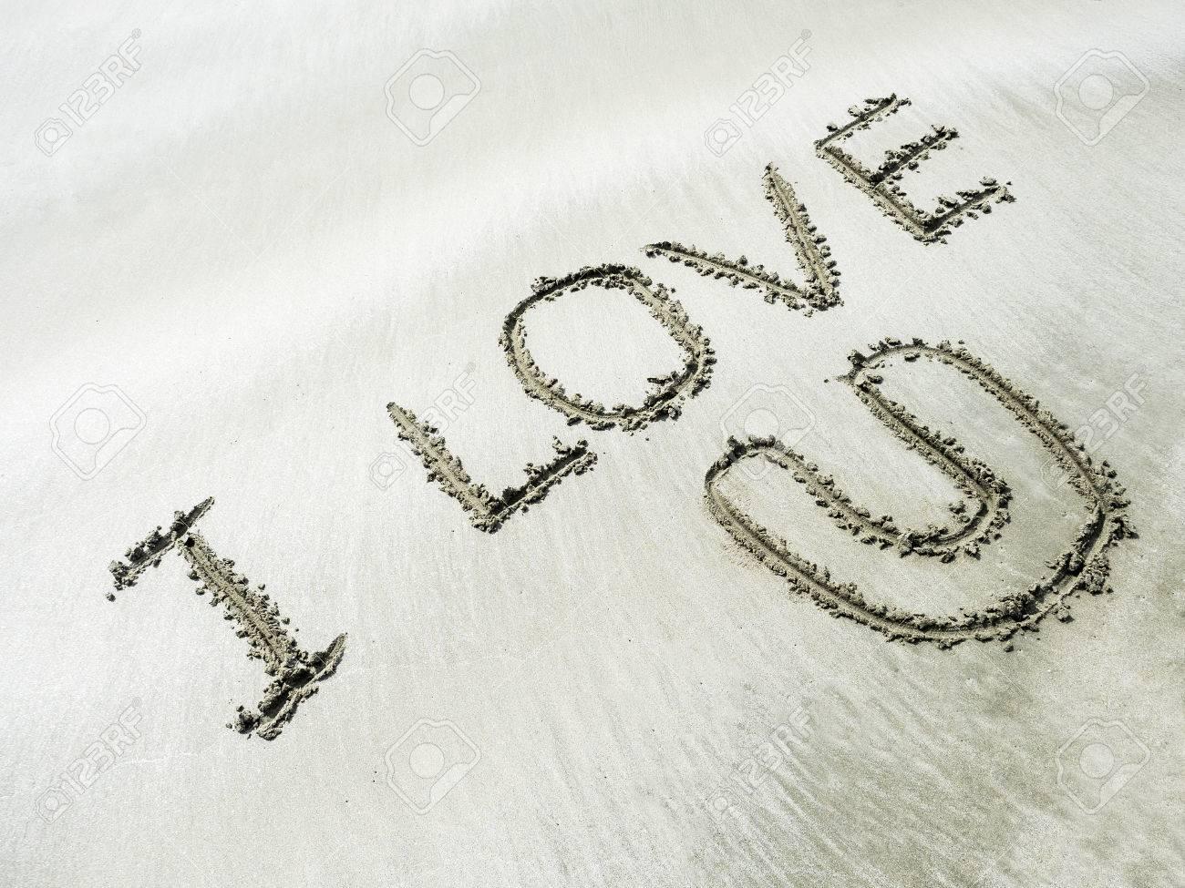 The Word I Love U Writing On White Sand In The Sea Beach Stock