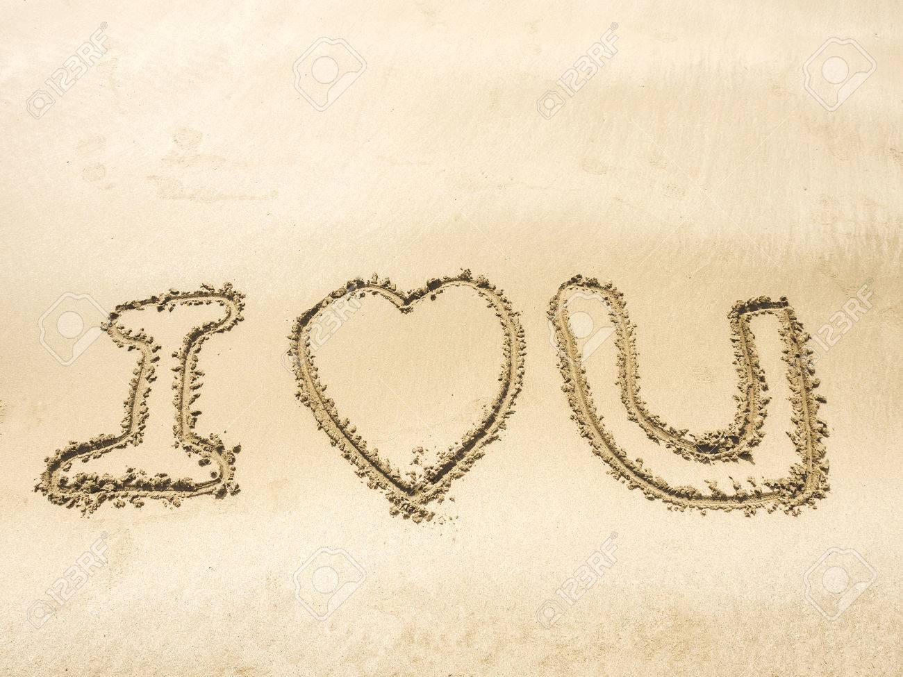 The Word I Love U Writing On Sand In The Sea Beach Light Stock