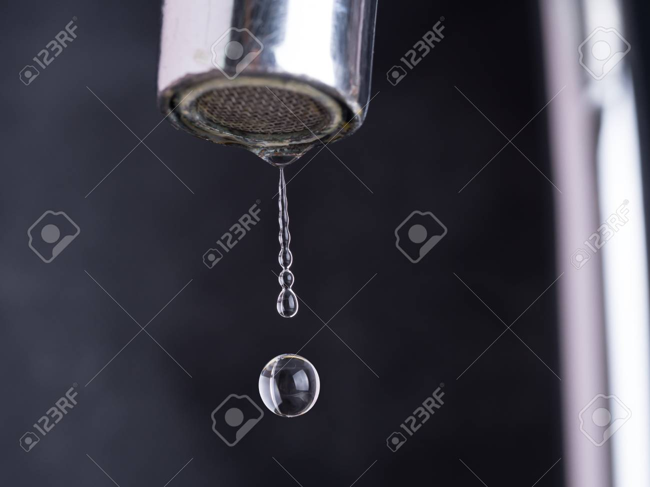 Close Up Shot On Water Drop From Faucet In Stop Motion Stock Photo ...