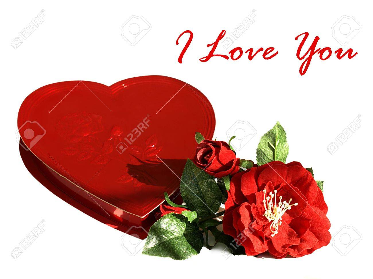 Photo of a heart shaped red box of chocolates with silk red roses and the text I love you Stock Photo - 4175848