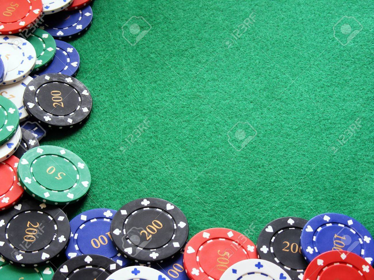 A Selection Of Diffirent Value Poker Chips On A Green Felt Poker