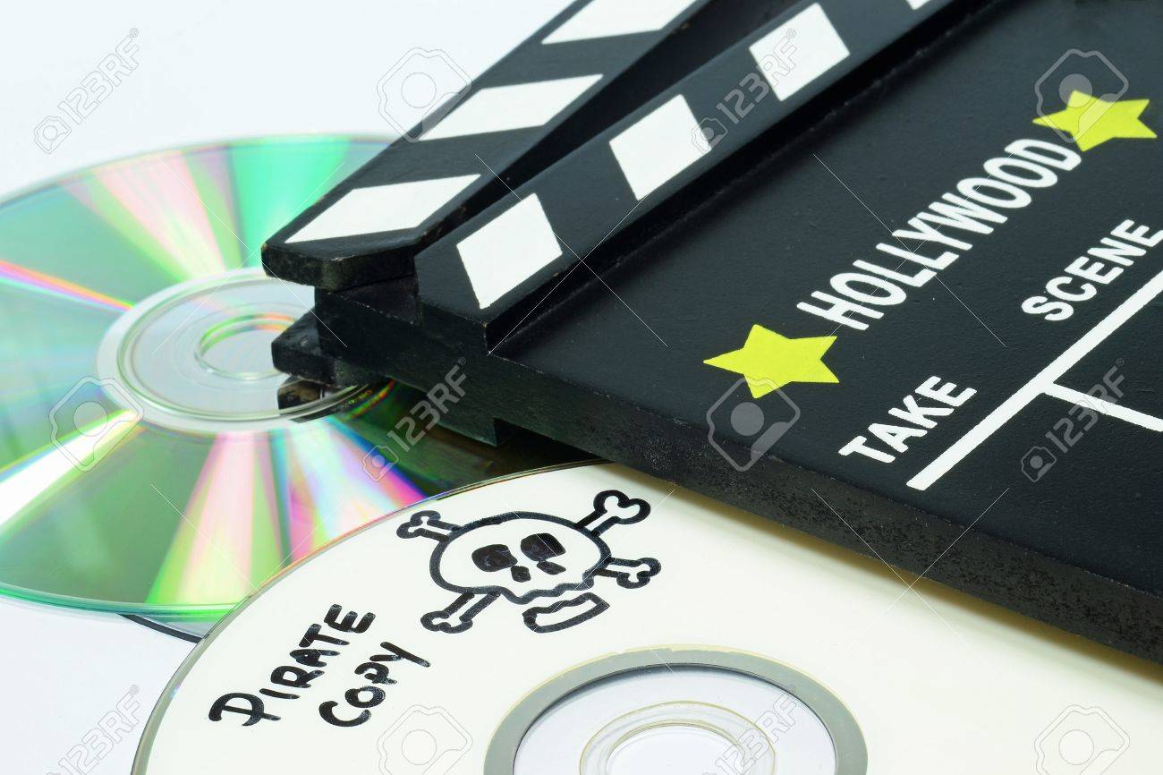 Pirate Copy written on a dvd next to a clapper board Stock Photo - 14034602