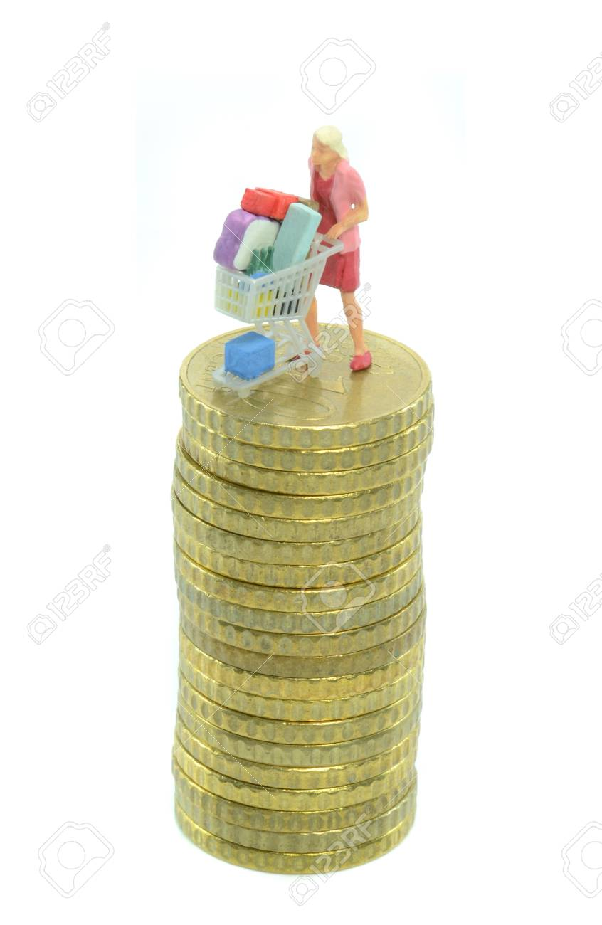 Woman with shopping cart trolley on a pile of coins Stock Photo - 16115936