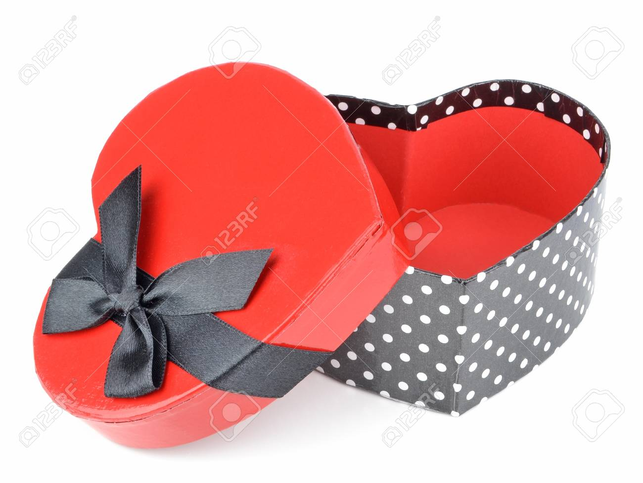A love heart shaped gift box with bow on white background Stock Photo - 17275728