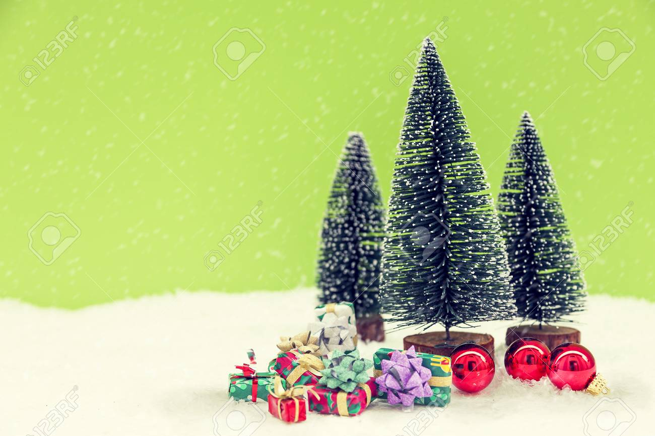 Miniature Of Christmas Trees With Colored Gifts Boxes In The.. Stock ...