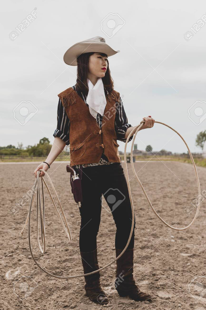 Pretty Chinese Cowgirl Throwing The Lasso In A Horse Paddock Stock Photo Picture And Royalty Free Image Image 137677292