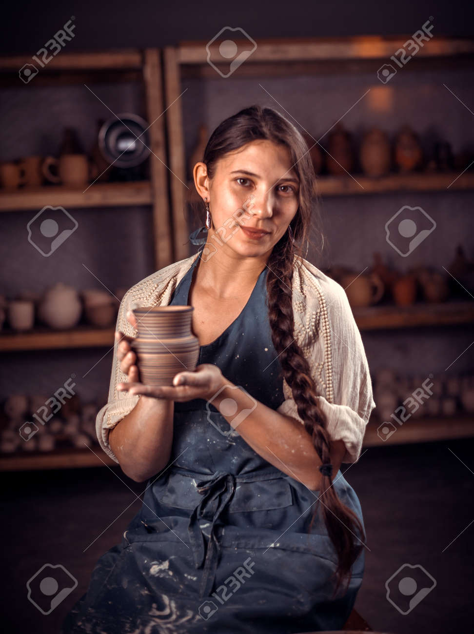 Charming Ceramist Woman Shows How To Work With Clay And Pottery Stock Photo Picture And Royalty Free Image Image 158908462