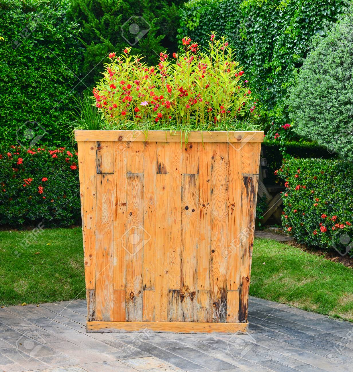 Big Wood Fllowerpot In The Garden Stock Photo, Picture And Royalty