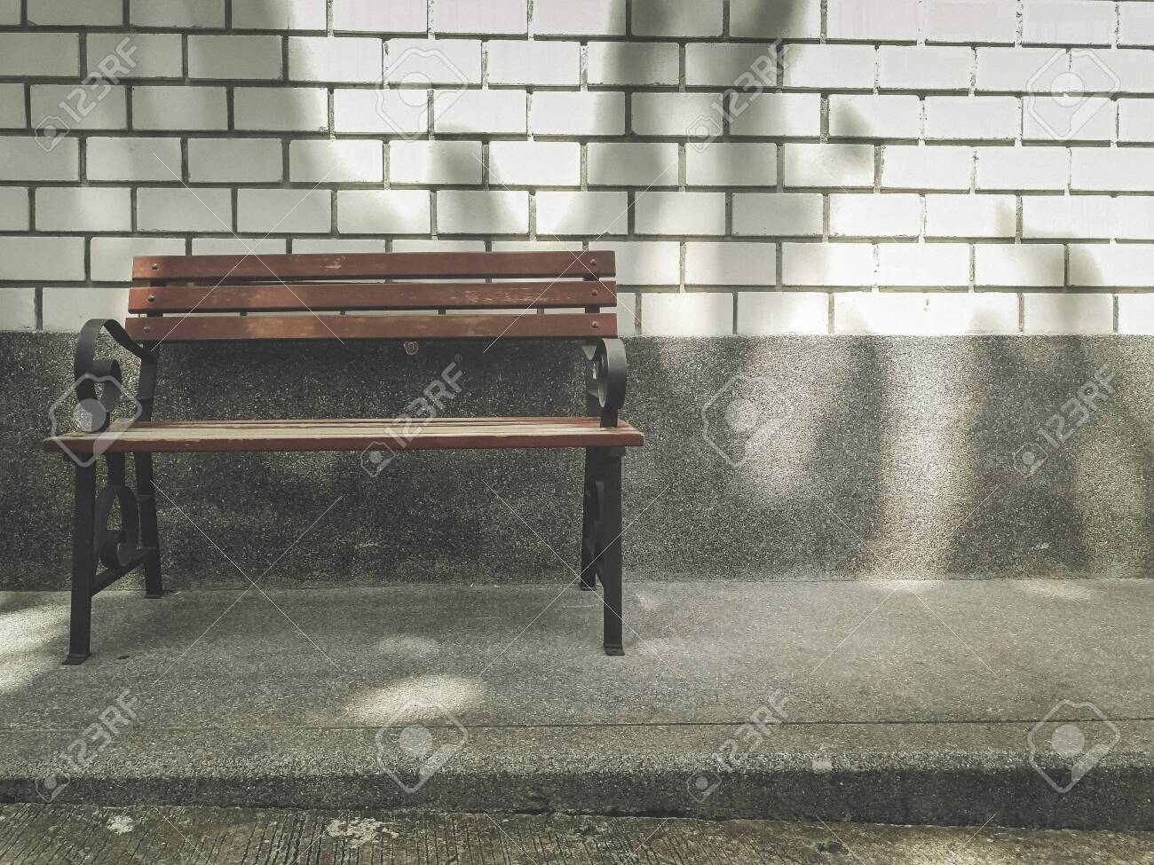 Super Brown Bench With White Brick Wall And At The Park Vintage Image Theyellowbook Wood Chair Design Ideas Theyellowbookinfo