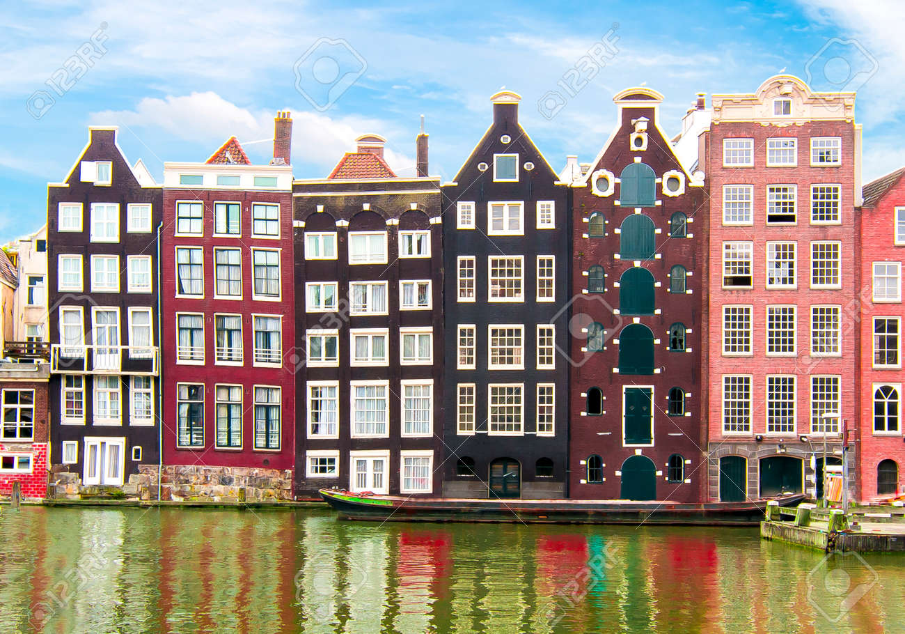 Buildings on Damrak canal, Amsterdam architecture, Netherlands - 148450398